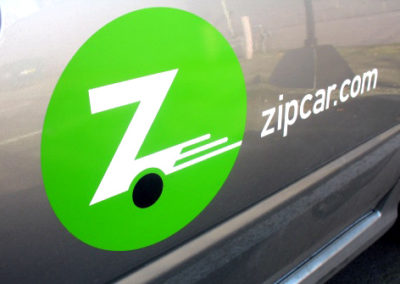 Zip car and Enterprise car sharing programs have multiple vehicles nearby.